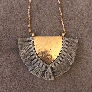 Long necklace with fringey emblem